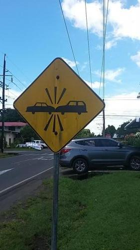 Sign at intersection with no stop sign; also seen this sign with a truck and a car on it